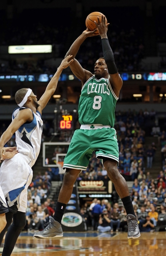 Nov 16, 2013; Minneapolis, MN, USA; Boston Celtics shooting guard Jeff Green (8) goes up for a shot over Minnesota Timberwolves small forward Corey Brewer (13) in the first half at Target Center. Mandatory Credit: Jesse Johnson-USA TODAY Sports