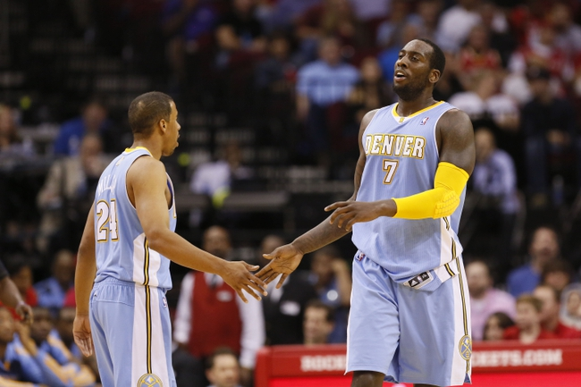 Nov 16, 2013; Houston, TX, USA; Denver Nuggets forward JJ Hickson (7) celebrates a score with guard Andre Miller (24) during the first half against the Houston Rockets at Toyota Center. Mandatory Credit: Soobum Im-USA TODAY Sports