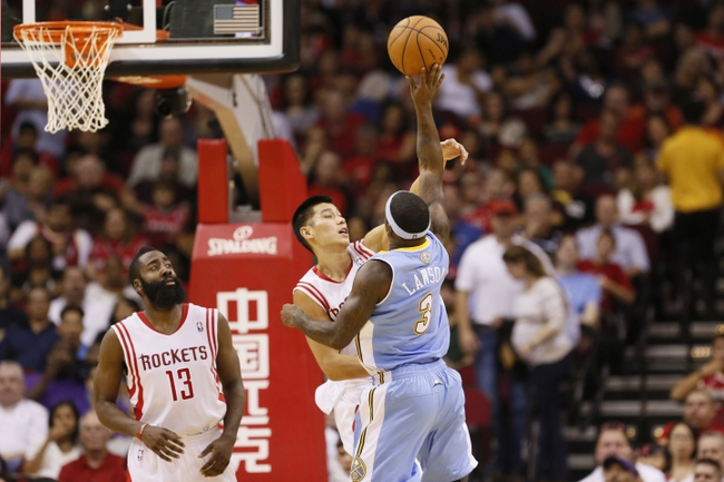 Nov 16, 2013; Houston, TX, USA; Denver Nuggets guard Ty Lawson (3) takes a shot over Houston Rockets guard Jeremy Lin (behind) during the first half at Toyota Center. Mandatory Credit: Soobum Im-USA TODAY Sports