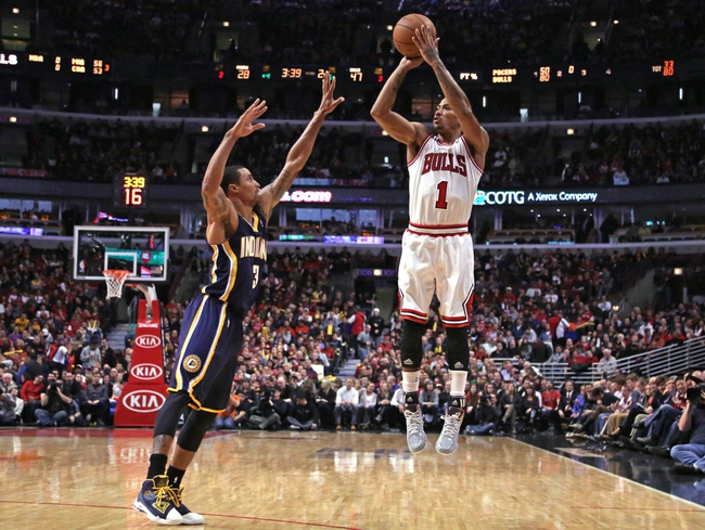 Nov 16, 2013; Chicago, IL, USA; Chicago Bulls point guard Derrick Rose (1) shoots over Indiana Pacers point guard George Hill (3) during the second quarter at  the United Center. Mandatory Credit: Dennis Wierzbicki-USA TODAY Sports