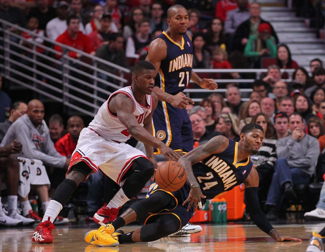 Nov 16, 2013; Chicago, IL, USA; Chicago Bulls shooting guard Jimmy Butler (21) steals the ball from Indiana Pacers small forward Paul George (24) during the second quarter at  the United Center. Mandatory Credit: Dennis Wierzbicki-USA TODAY Sports