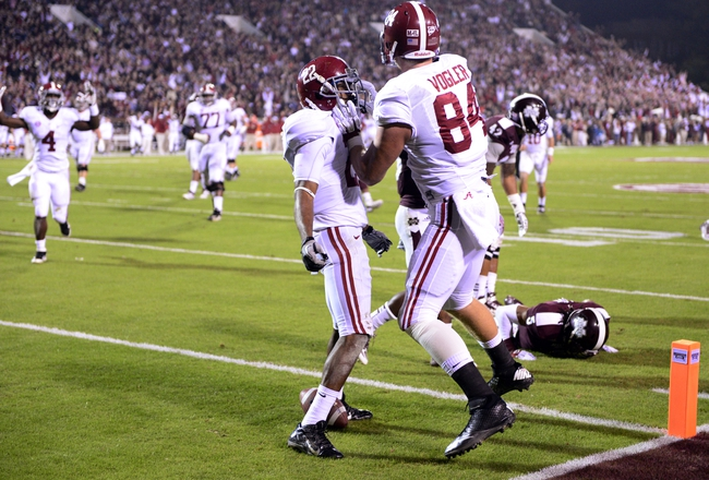 Nov 16, 2013; Starkville, MS, USA; Alabama Crimson Tide tight end Brian Vogler (84) celebrates his touchdown with wide receiver Christion Jones (22)  in the end zone past Mississippi State Bulldogs defensive back Jamerson Love (5) during the second quarter at Davis Wade Stadium. Mandatory Credit: John David Mercer-USA TODAY Sports