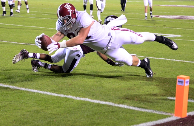 Nov 16, 2013; Starkville, MS, USA; Alabama Crimson Tide tight end Brian Vogler (84) dives to the end zone past Mississippi State Bulldogs defensive back Jamerson Love (5) for a touchdown during the second quarter at Davis Wade Stadium. Mandatory Credit: John David Mercer-USA TODAY Sports
