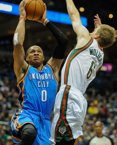 Nov 16, 2013; Milwaukee, WI, USA;   Oklahoma City Thunder guard Russell Westbrook (0) shoots a basket against Milwaukee Bucks guard Nate Wolters (6) in the 1st quarter at BMO Harris Bradley Center. Mandatory Credit: Benny Sieu-USA TODAY Sports
