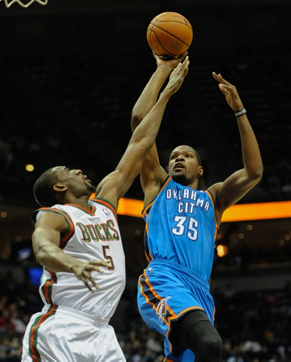 Nov 16, 2013; Milwaukee, WI, USA; Oklahoma City Thunder forward Kevin Durant (35) shoots a basket against Milwaukee Bucks forward Ekpe Udoh (5) in the 1st quarter  at BMO Harris Bradley Center. Mandatory Credit: Benny Sieu-USA TODAY Sports