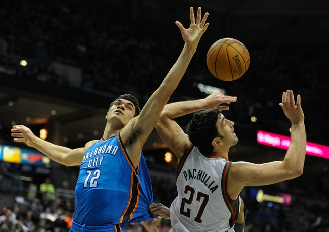 Nov 16, 2013; Milwaukee, WI, USA;   Oklahoma City Thunder center Steven Adams (12) and Milwaukee Bucks center Zaza Pachulia (27) battle for a rebound in the 2nd quarter at BMO Harris Bradley Center. Mandatory Credit: Benny Sieu-USA TODAY Sports