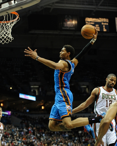 Nov 16, 2013; Milwaukee, WI, USA;   Oklahoma City Thunder guard Jeremy Lamb (11) dunks the ball past Milwaukee Bucks guard Gary Neal (12) in the 2nd quarter at BMO Harris Bradley Center. Mandatory Credit: Benny Sieu-USA TODAY Sports