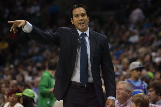 Nov 16, 2013; Charlotte, NC, USA; Miami Heat head coach Erik Spoelstra reacts to a call during the second half against the Charlotte Bobcats at Time Warner Cable Arena. Miami defeated Charlotte 97-81. Mandatory Credit: Jeremy Brevard-USA TODAY Sports