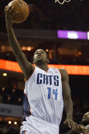 Nov 16, 2013; Charlotte, NC, USA; Charlotte Bobcats small forward Michael Kidd-Gilchrist (14) goes up for a shot against the Miami Heat during the second half at Time Warner Cable Arena. Miami defeated Charlotte 97-81. Mandatory Credit: Jeremy Brevard-USA TODAY Sports