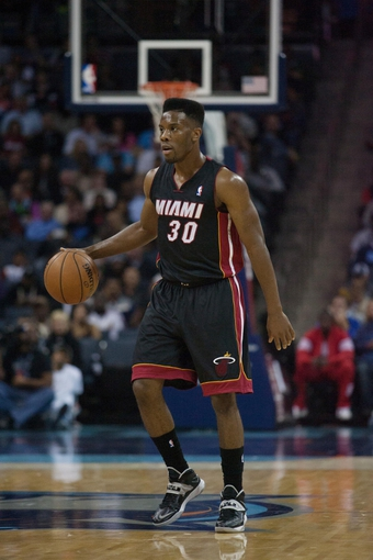 Nov 16, 2013; Charlotte, NC, USA; Miami Heat point guard Norris Cole (30) brings the ball down the court in the first half against the Charlotte Bobcats at Time Warner Cable Arena. Miami defeated Charlotte 97-81. Mandatory Credit: Jeremy Brevard-USA TODAY Sports