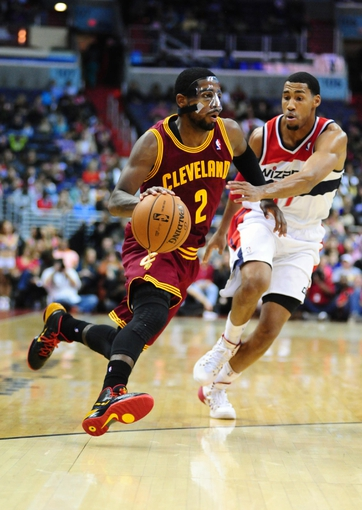 Nov 16, 2013; Washington, DC, USA; Cleveland Cavaliers guard Kyrie Irving (2) dribbles past Washington Wizards guard Garrett Temple (17) at Verizon Center. Mandatory Credit: Evan Habeeb-USA TODAY Sports