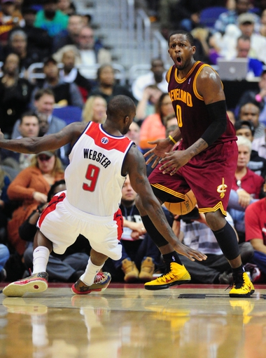 Nov 16, 2013; Washington, DC, USA; Cleveland Cavaliers guard C.J. Miles (0) reacts after being called for an offensive could against Washington Wizards forward Martell Webster (9) at Verizon Center. Mandatory Credit: Evan Habeeb-USA TODAY Sports
