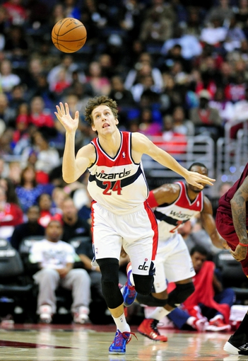Nov 16, 2013; Washington, DC, USA; Washington Wizards forward Jan Vesely (24) reaches for a loose ball during the game against the Cleveland Cavaliers at Verizon Center. Mandatory Credit: Evan Habeeb-USA TODAY Sports