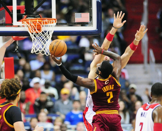 Nov 16, 2013; Washington, DC, USA; Cleveland Cavaliers guard Kyrie Irving (2) shoots the ball over Washington Wizards center Marcin Gortat (4) at Verizon Center. Mandatory Credit: Evan Habeeb-USA TODAY Sports