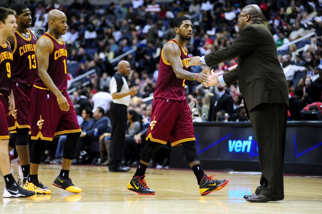 Nov 16, 2013; Washington, DC, USA; Cleveland Cavaliers guard Kyrie Irving (2) high fives head coach Mike Brown (right) in the fourth quarter against the Washington Wizards at Verizon Center. Mandatory Credit: Evan Habeeb-USA TODAY Sports