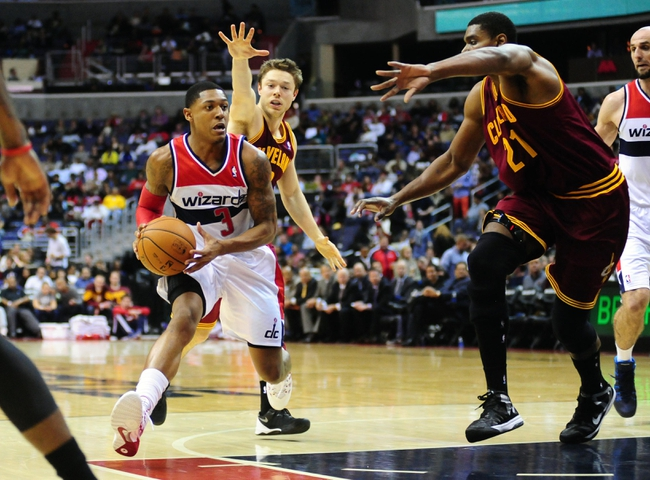 Nov 16, 2013; Washington, DC, USA; Washington Wizards guard Bradley Beal (3) dribbles while being guarded by Cleveland Cavaliers center Andrew Bynum (21) at Verizon Center. Mandatory Credit: Evan Habeeb-USA TODAY Sports