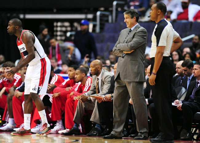 Nov 16, 2013; Washington, DC, USA; Washington Wizards head coach Randy Wittman (center) looks on during the game against the Cleveland Cavaliers at Verizon Center. Mandatory Credit: Evan Habeeb-USA TODAY Sports