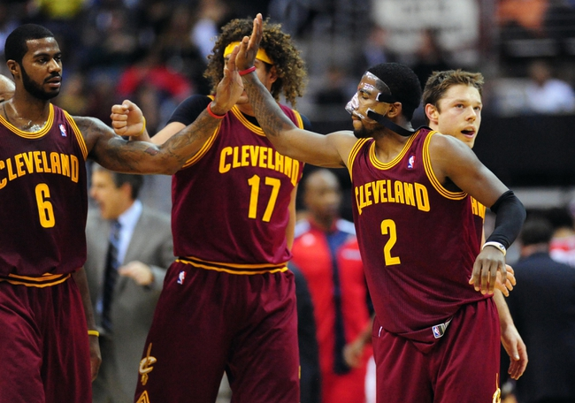 Nov 16, 2013; Washington, DC, USA; Cleveland Cavaliers guard Kyrie Irving (2) high fives guard Earl Clark (6) in the fourth quarter against the Washington Wizards at Verizon Center. Mandatory Credit: Evan Habeeb-USA TODAY Sports