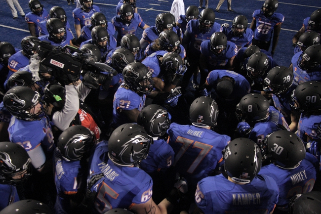 Nov 16, 2013; Boise, ID, USA; Boise State Broncos huddle prior to kick off against the Wyoming Cowboys at Bronco Stadium. Mandatory Credit: Brian Losness-USA TODAY Sports