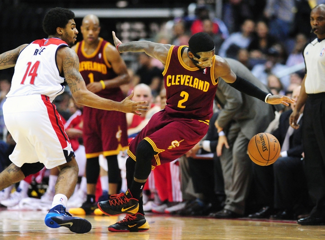 Nov 16, 2013; Washington, DC, USA; Cleveland Cavaliers guard Kyrie Irving (2) dribbles behind his back while being guarded by Washington Wizards guard Glen Rice (14) at Verizon Center. Mandatory Credit: Evan Habeeb-USA TODAY Sports
