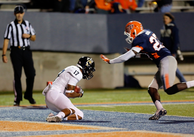 Nov 16, 2013; El Paso, TX, USA;  FIU Golden Panthers receiver T.J. Lowder (17) catches a touchdown pass against the UTEP Miners defense at Sun Bowl Stadium. Mandatory Credit: Ivan Pierre Aguirre-USA TODAY Sports
