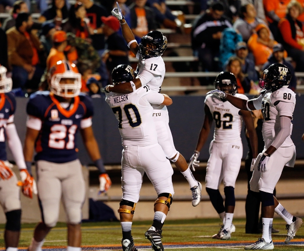 Nov 16, 2013; El Paso, TX, USA;  FIU Golden Panthers receiver T.J. Lowder (17) celebrates after catching a downtown pass against the UTEP Miners defense at Sun Bowl Stadium. Mandatory Credit: Ivan Pierre Aguirre-USA TODAY Sports