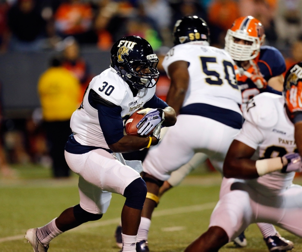 Nov 16, 2013; El Paso, TX, USA;  FIU Golden Panthers Silas Spearman III (30) runs the ball against the UTEP Miners defense at Sun Bowl Stadium. Mandatory Credit: Ivan Pierre Aguirre-USA TODAY Sports