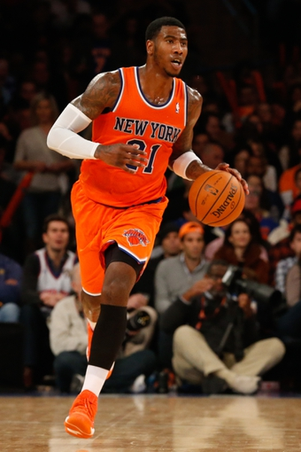 Nov 16, 2013; New York, NY, USA;  New York Knicks shooting guard Iman Shumpert (21) drives the ball during the third quarter against the Atlanta Hawks at Madison Square Garden. Atlanta Hawks won 110-90.  Mandatory Credit: Anthony Gruppuso-USA TODAY Sports