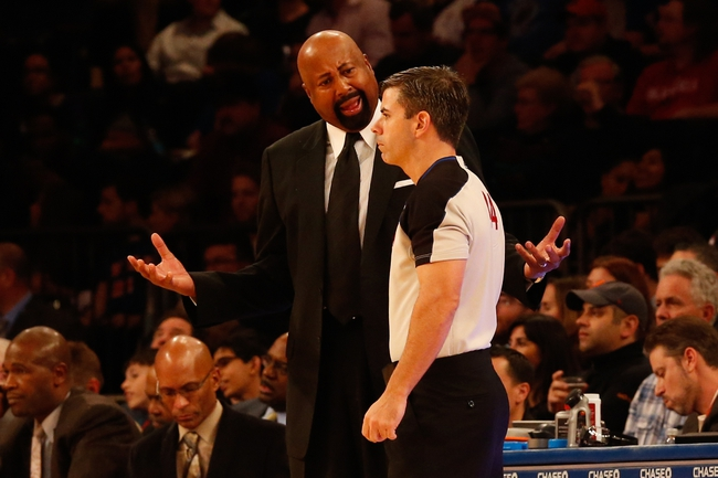Nov 16, 2013; New York, NY, USA;  New York Knicks head coach Mike Woodson argues a call with referee Eli Roe (44) during the third quarter against the Atlanta Hawks at Madison Square Garden. Atlanta Hawks won 110-90.  Mandatory Credit: Anthony Gruppuso-USA TODAY Sports