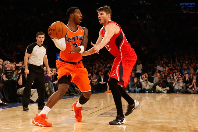 Nov 16, 2013; New York, NY, USA;  New York Knicks shooting guard Iman Shumpert (21) controls the ball against Atlanta Hawks shooting guard Kyle Korver (26)  during the fourth quarter at Madison Square Garden. Atlanta Hawks won 110-90.  Mandatory Credit: Anthony Gruppuso-USA TODAY Sports