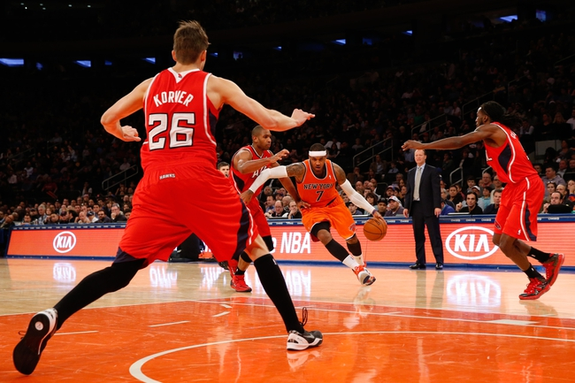 Nov 16, 2013; New York, NY, USA;  New York Knicks small forward Carmelo Anthony (7) drives between Atlanta Hawks defense during the fourth quarter at Madison Square Garden. Atlanta Hawks won 110-90.  Mandatory Credit: Anthony Gruppuso-USA TODAY Sports