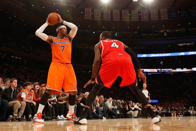 Nov 16, 2013; New York, NY, USA; New York Knicks small forward Carmelo Anthony (7) controls the ball against Atlanta Hawks power forward Paul Millsap (4) during the fourth quarter at Madison Square Garden. Atlanta Hawks won 110-90.  Mandatory Credit: Anthony Gruppuso-USA TODAY Sports