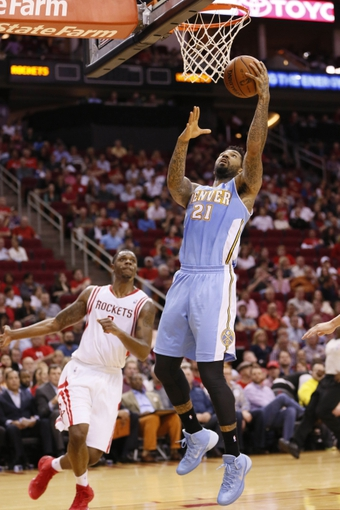 Nov 16, 2013; Houston, TX, USA; Denver Nuggets forward Wilson Chandler (21) shoots the ball against the Houston Rockets during the second half at Toyota Center. The Rockets won 122-111. Mandatory Credit: Soobum Im-USA TODAY Sports