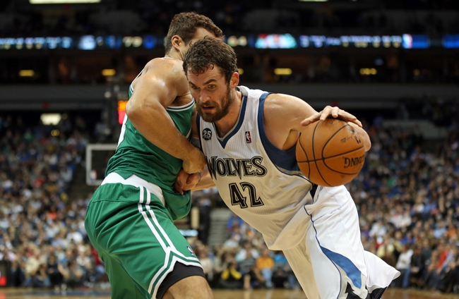 Nov 16, 2013; Minneapolis, MN, USA; Minnesota Timberwolves power forward Kevin Love (42) drives to the basket past Boston Celtics power forward Kris Humphries (43) in the second half at Target Center. The TImberwolves won 106-88. Mandatory Credit: Jesse Johnson-USA TODAY Sports