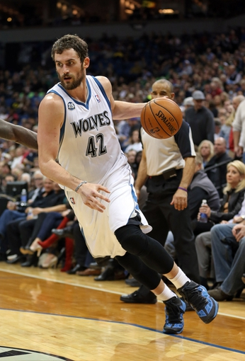 Nov 16, 2013; Minneapolis, MN, USA; Minnesota Timberwolves power forward Kevin Love (42) drives to the basket in the second half against the Boston Celtics at Target Center. The Timberwolves won 106-88. Mandatory Credit: Jesse Johnson-USA TODAY Sports