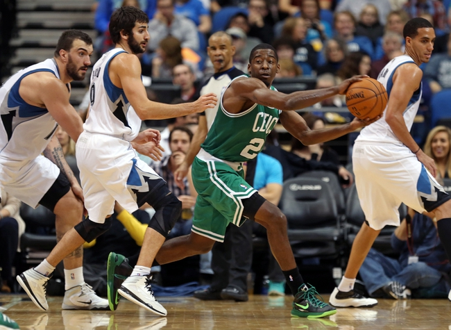 Nov 16, 2013; Minneapolis, MN, USA; Boston Celtics shooting guard Jordan Crawford (27) attempts to make a pass in the second half around Minnesota Timberwolves point guard Ricky Rubio (9) at Target Center. The TImberwolves won 106-88. Mandatory Credit: Jesse Johnson-USA TODAY Sports
