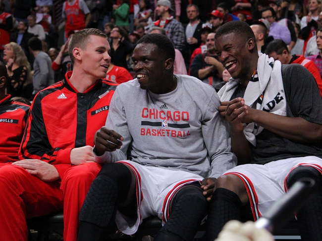 Nov 16, 2013; Chicago, IL, USA; Chicago Bulls power forward Erik Murphy (left) and small forward Luol Deng (center) and shooting guard Jimmy Butler (right) laugh on the bench during the second half against the Indiana Pacers at  the United Center. Chicago won 110-94. Mandatory Credit: Dennis Wierzbicki-USA TODAY Sports