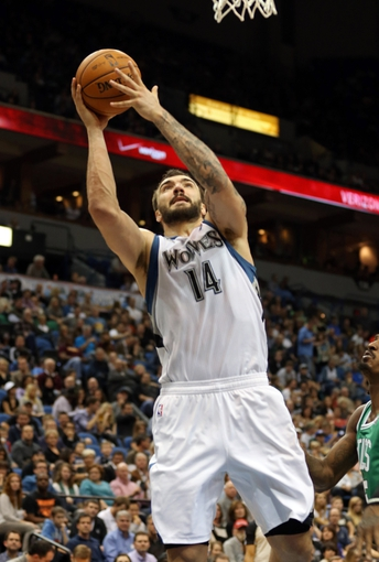 Nov 16, 2013; Minneapolis, MN, USA; Minnesota Timberwolves center Nikola Pekovic (14) goes up for a layup in the second half against the Boston Celtics at Target Center. The Timberwolves won 106-88. Mandatory Credit: Jesse Johnson-USA TODAY Sports