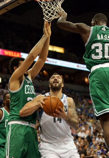 Nov 16, 2013; Minneapolis, MN, USA; Minnesota Timberwolves center Nikola Pekovic (14) attempts to go up for a shot through Boston Celtics center Vitor Faverani (38) and power forward Brandon Bass (30) in the second half at Target Center. The Timberwolves won 106-88. Mandatory Credit: Jesse Johnson-USA TODAY Sports