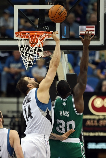 Nov 16, 2013; Minneapolis, MN, USA; Minnesota Timberwolves center Nikola Pekovic (14) attempts to block a shot from Boston Celtics power forward Brandon Bass (30) in the second half at Target Center. The Timberwolves won 106-88. Mandatory Credit: Jesse Johnson-USA TODAY Sports