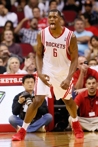 Nov 16, 2013; Houston, TX, USA; Houston Rockets forward Terrence Jones (6) reacts after a shot during the second half against the Denver Nuggets at Toyota Center. The Rockets won 122-111. Mandatory Credit: Soobum Im-USA TODAY Sports