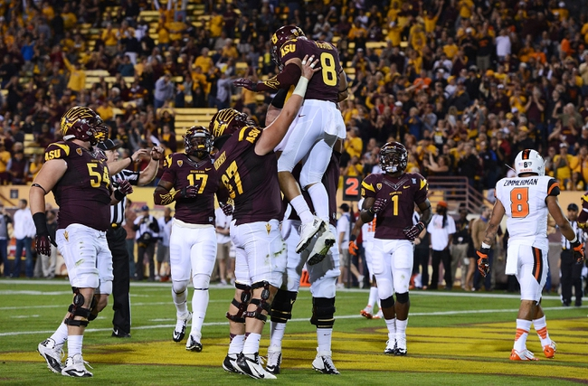 Nov 16, 2013; Tempe, AZ, USA; Arizona State Sun Devils running back D.J. Foster (8) celebrates with teammates after scoring an 8 yard touchdown in the second quarter against the Oregon State Beavers at Sun Devil Stadium. Mandatory Credit: Jennifer Stewart-USA TODAY Sports