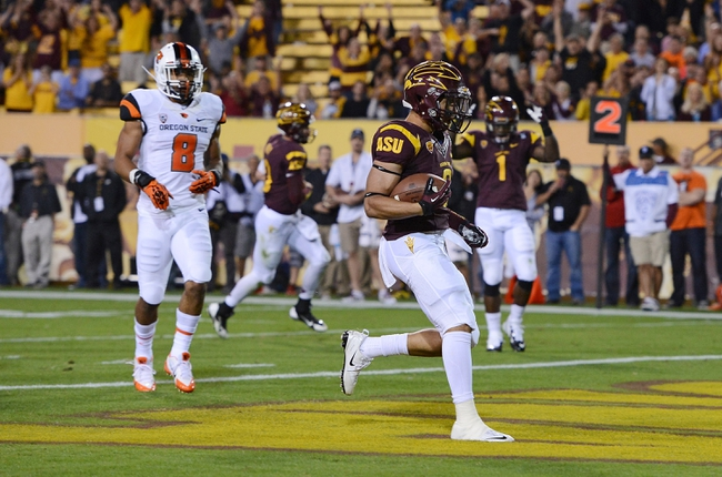 Nov 16, 2013; Tempe, AZ, USA; Arizona State Sun Devils running back D.J. Foster (8) scores an 8 yard touchdown in the second quarter against the Oregon State Beavers at Sun Devil Stadium. Mandatory Credit: Jennifer Stewart-USA TODAY Sports