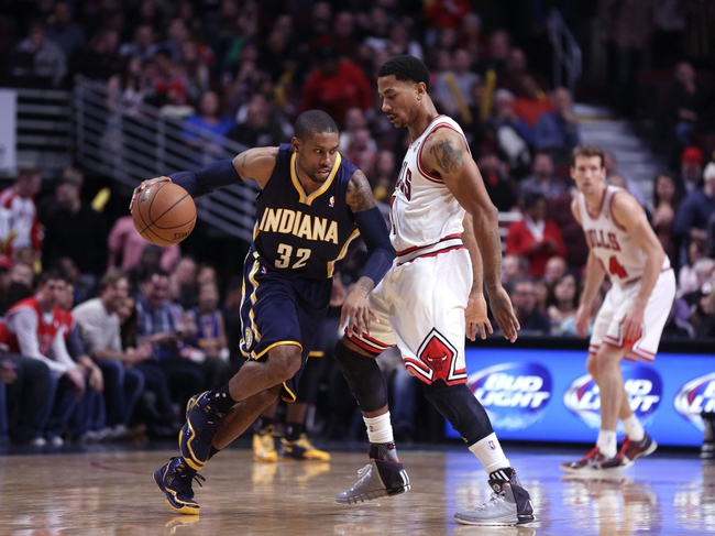 Nov 16, 2013; Chicago, IL, USA; Indiana Pacers point guard C.J. Watson (32) is defended by Chicago Bulls point guard Derrick Rose (1) during the second half at  the United Center. Chicago won 110-94. Mandatory Credit: Dennis Wierzbicki-USA TODAY Sports