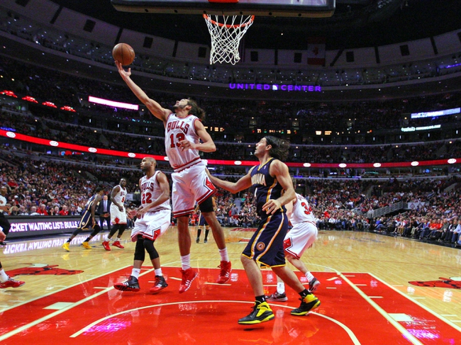 Nov 16, 2013; Chicago, IL, USA; Chicago Bulls center Joakim Noah (13) rebounds over Indiana Pacers power forward Luis Scola (4)during the second half at  the United Center. Chicago won 110-94. Mandatory Credit: Dennis Wierzbicki-USA TODAY Sports