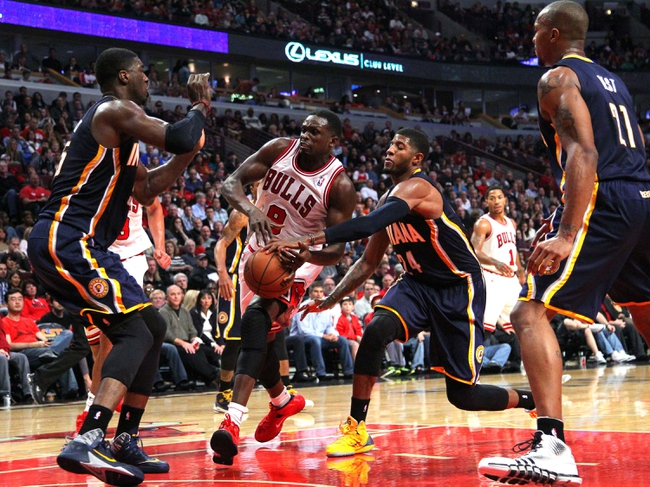 Nov 16, 2013; Chicago, IL, USA; Indiana Pacers small forward Paul George (24) steals the ball from Chicago Bulls small forward Luol Deng (9) during the second half at  the United Center. Chicago won 110-94. Mandatory Credit: Dennis Wierzbicki-USA TODAY Sports
