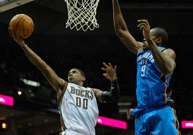 Nov 16, 2013; Milwaukee, WI, USA;   Milwaukee Bucks guard O.J. Mayo (00) shoots a basket against Oklahoma City Thunder forward Serge Ibaka (9) in the 3rd quarter at BMO Harris Bradley Center. Mandatory Credit: Benny Sieu-USA TODAY Sports