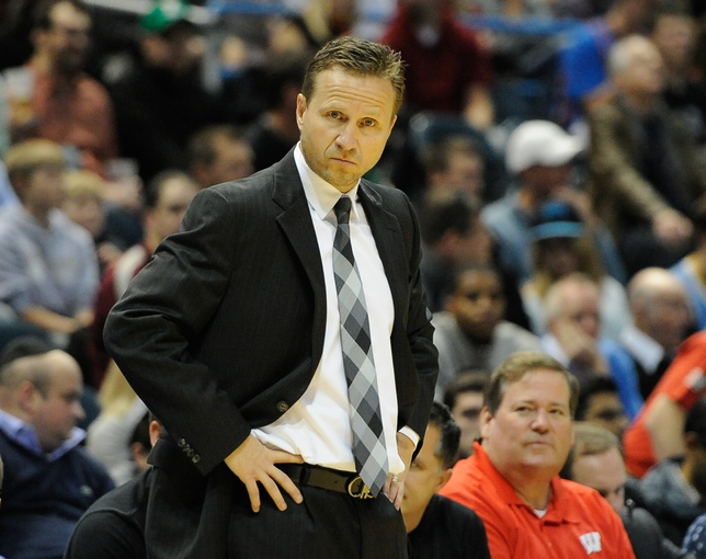 Nov 16, 2013; Milwaukee, WI, USA;  Oklahoma City Thunder head coach Scott Brooks watches play during the game against the Milwaukee Bucks in the 3rd quarter at BMO Harris Bradley Center. Mandatory Credit: Benny Sieu-USA TODAY Sports