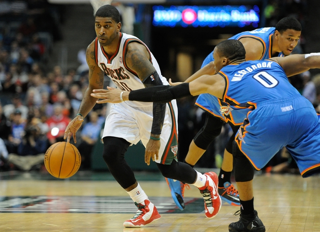 Nov 16, 2013; Milwaukee, WI, USA;   Milwaukee Bucks guard O.J. Mayo (00) moves the ball up court against Oklahoma City Thunder guard Russell Westbrook (0) in the 3rd quarter at BMO Harris Bradley Center. Mandatory Credit: Benny Sieu-USA TODAY Sports