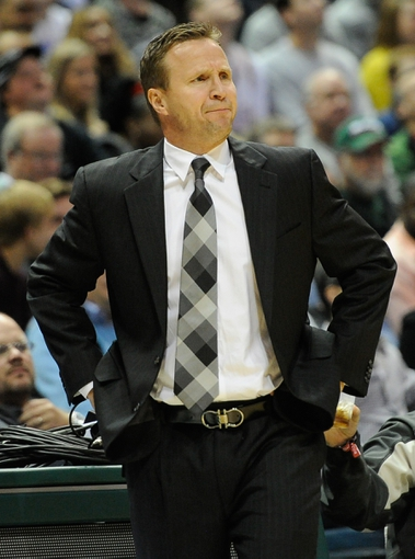 Nov 16, 2013; Milwaukee, WI, USA;   Oklahoma City Thunder head coach Scott Brooks watches play during the game against the Milwaukee Bucks in the 2nd quarter at BMO Harris Bradley Center. Mandatory Credit: Benny Sieu-USA TODAY Sports